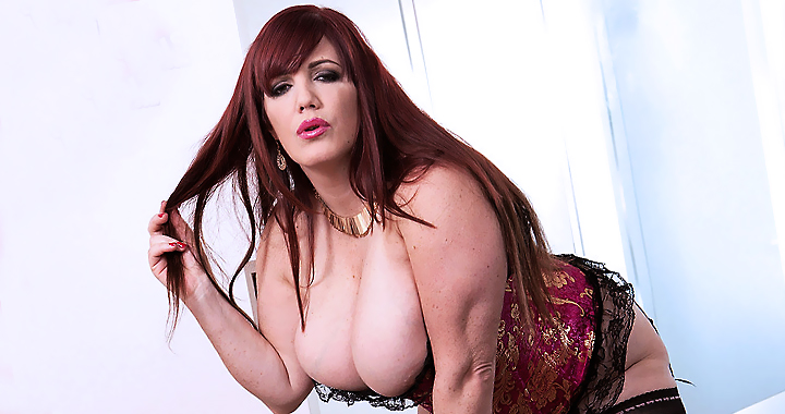 Her big boobs burst out of her lacy bustier
